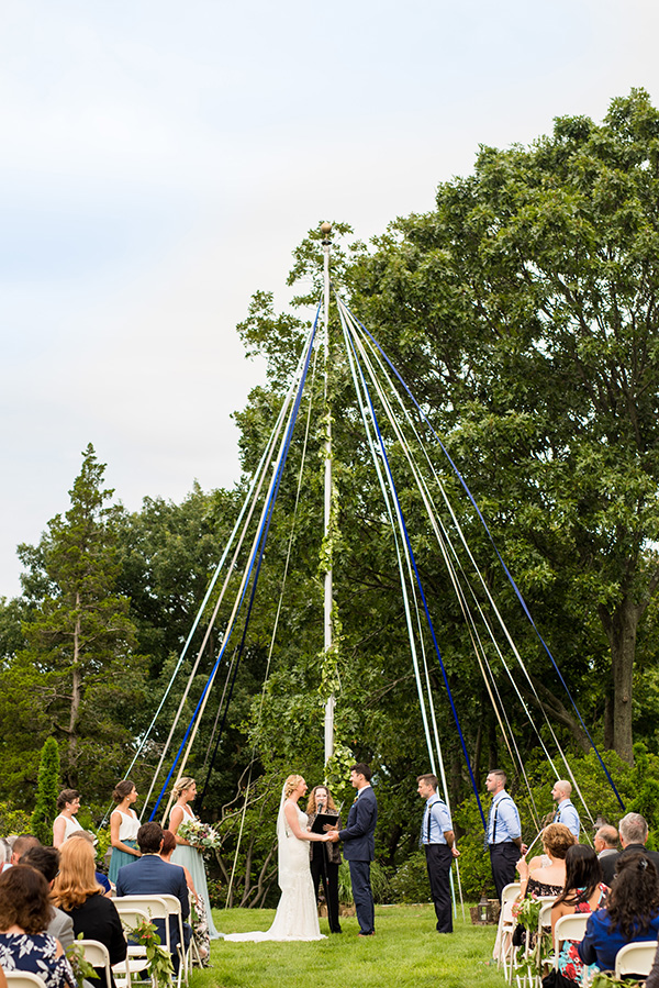 wedding ceremony with maypole or sailing inspired altar decor