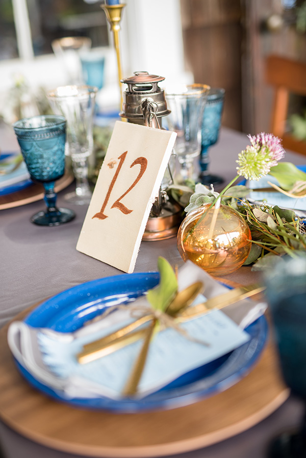 table number and place setting for a boho glamping theme wedding reception