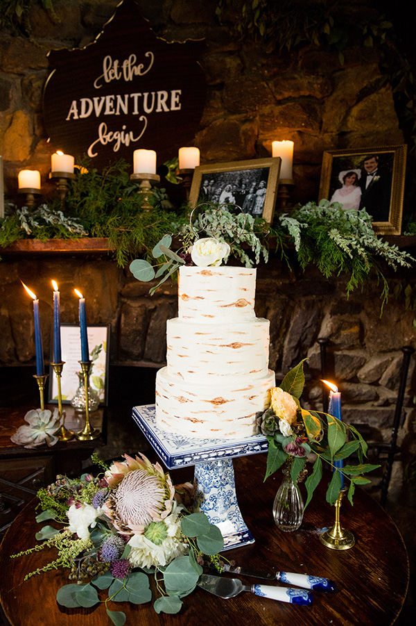 wedding cake with birch bark pattern on a cake stand