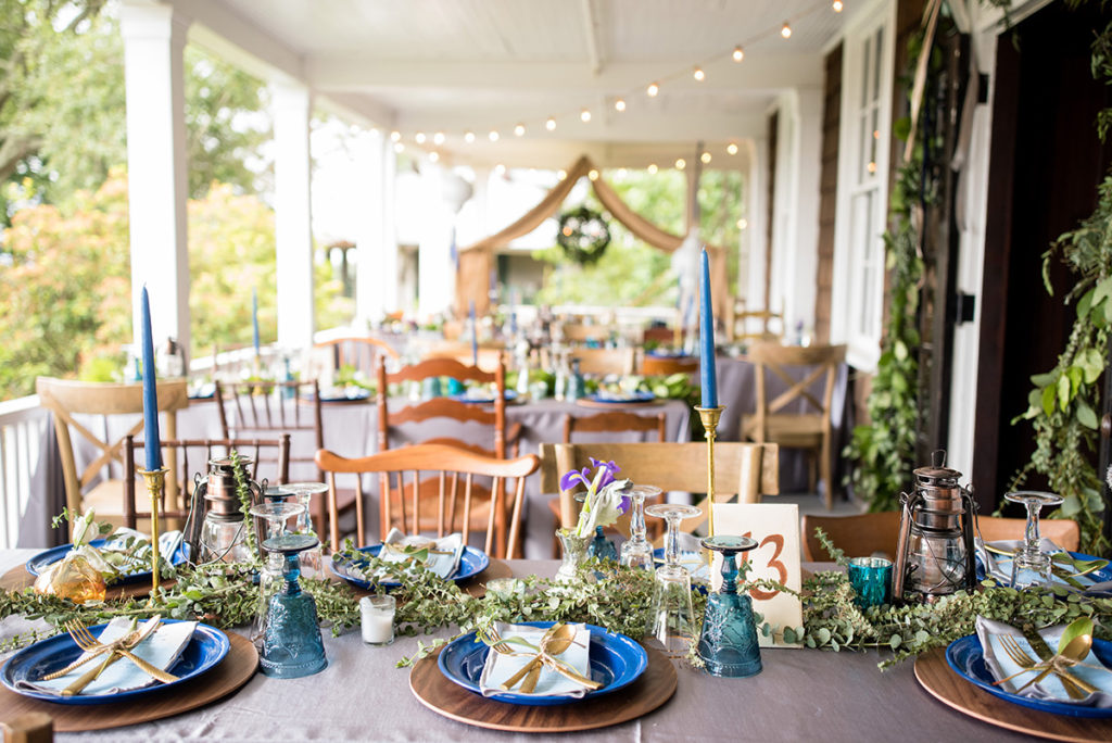 wedding reception table setting with a boho glamping theme