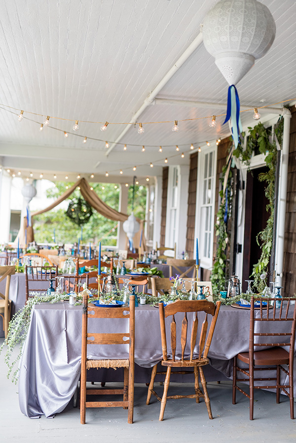 overview of tables set for a boho glamping theme wedding reception
