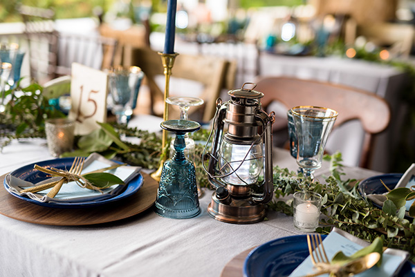 table setting and decor with a boho glamping theme featuring a camping lantern