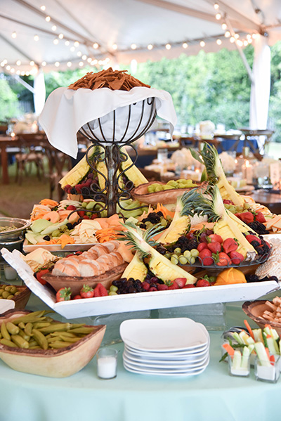 fruit and charcuterie table at a wedding reception