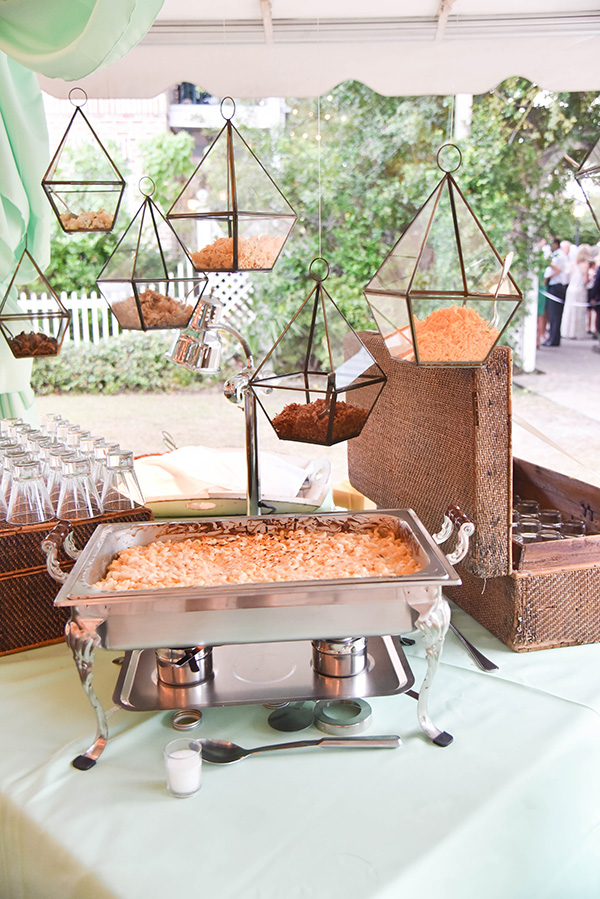 macaroni and cheese food station with glass containers with toppings suspended overhead