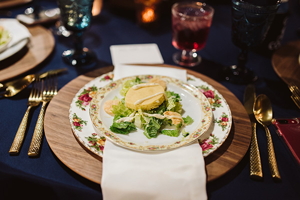 place setting with Southern Caesar Salad on china with a floral pattern