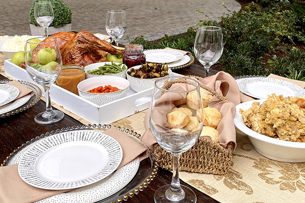 Thanksgiving dinner on a table set with china and wine glasses