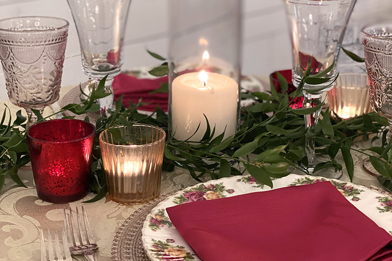 place setting with candles and red accents for Valentine's dinner